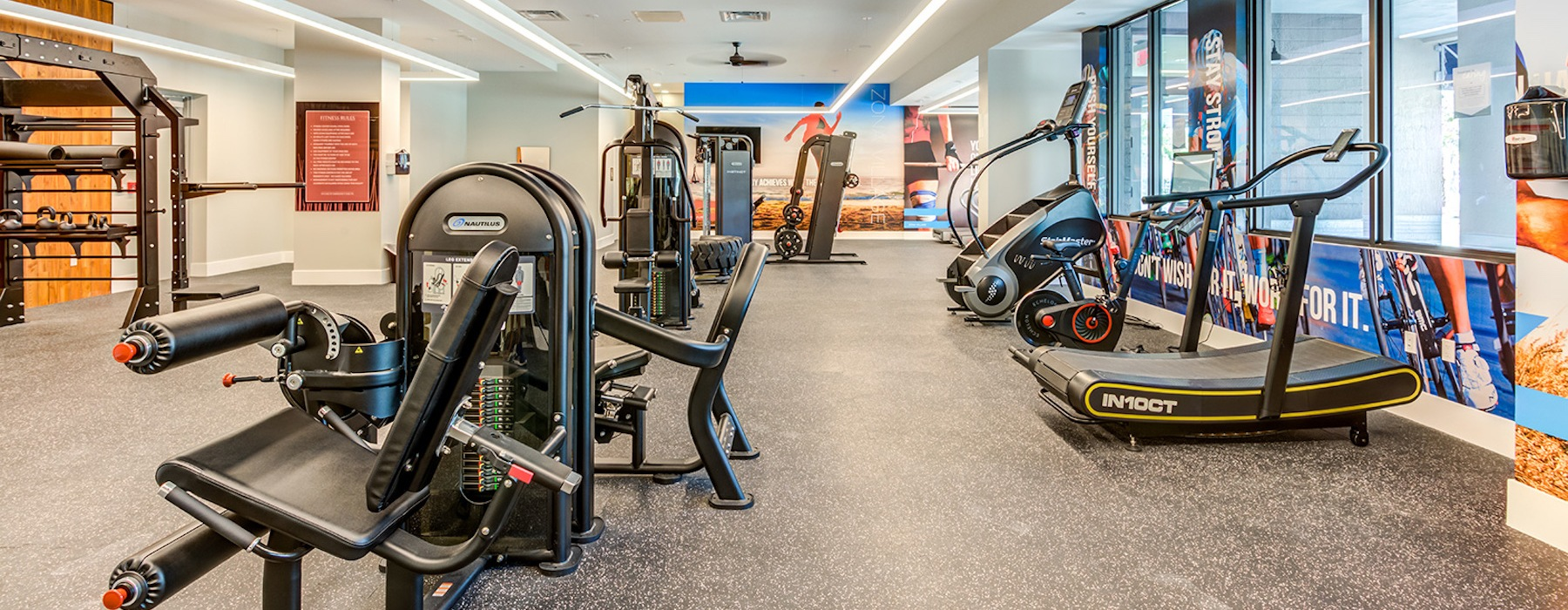 spacious fitness center with equipment and large, open spaces