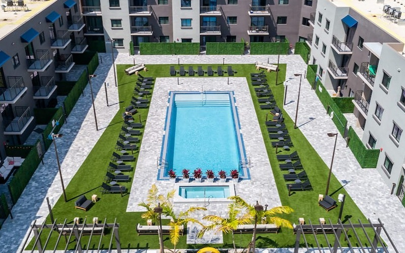 Aerial view of swimming pool showing spacious seating and easy access to apartment homes