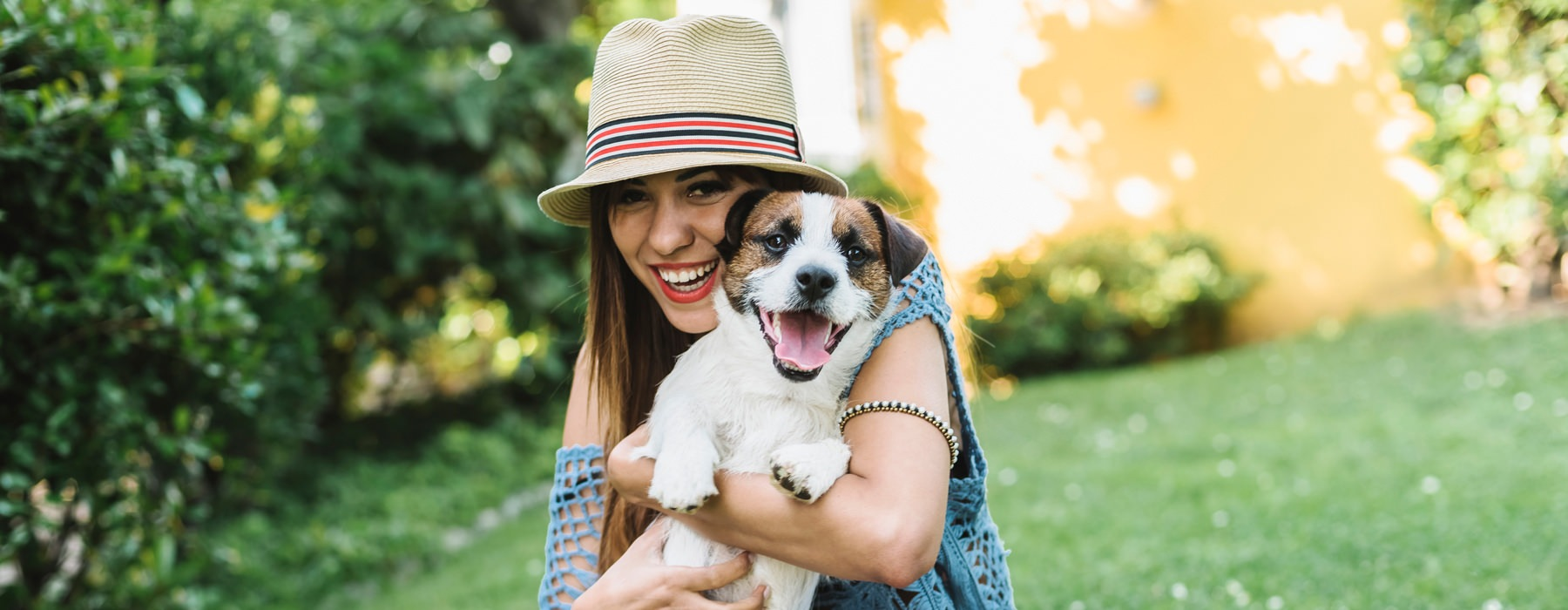 Lifestyle Image of young woman with her dog in a park